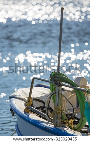 Fisher boat at the harbor of Santorini with defocussed sea in the background. Greece