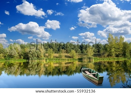 fisher boat on a river - stock photo