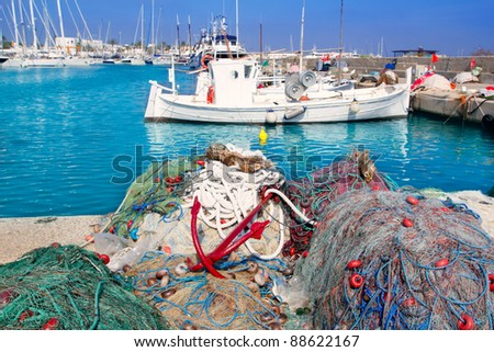 fisher boats with nets long lines buoy tackle in foreground at Formentera - stock photo