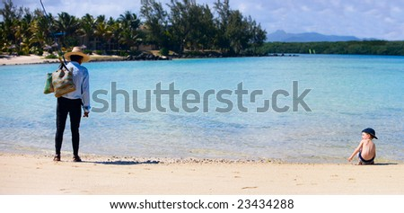 Fisherman and boy. Lifestyle scene from Mauritius - stock photo