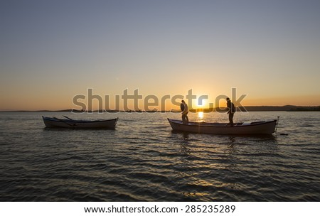 Fisherman and net - stock photo