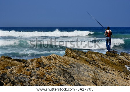 fisherman at algarve in the south of portugal - stock photo