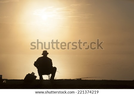 Fisherman at sunset. Harmony with nature. - stock photo