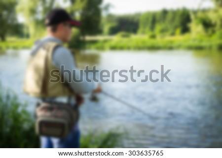 fisherman, blurred background - stock photo