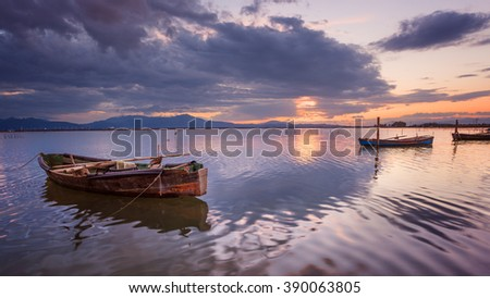 Fisherman boat's  in a perfect calm lagoon with amazing reflection at sunset  - stock photo