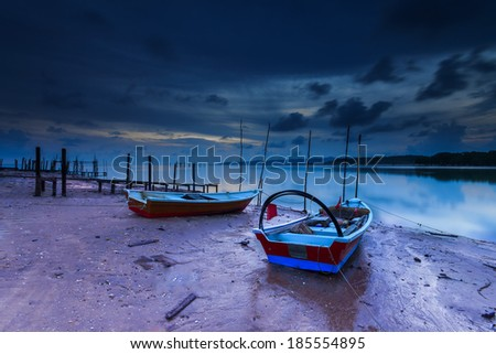 Fisherman boats during blue hour. - stock photo