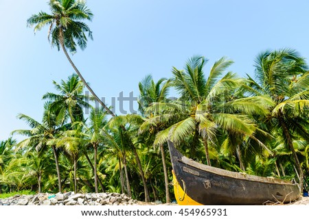 Fisherman boats on the beach at clear blue sky on a tropical bea