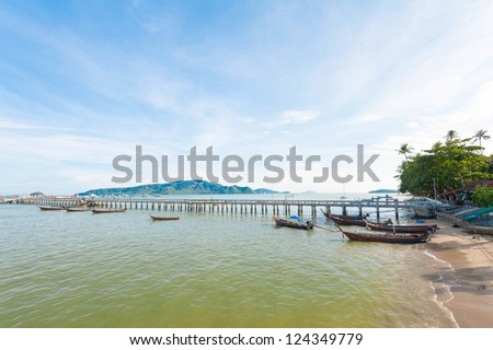 fisherman boats resting near bridge in Andaman sea, Phuket Thailand