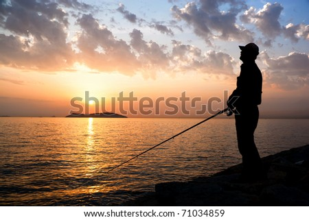 Fisherman by sunset