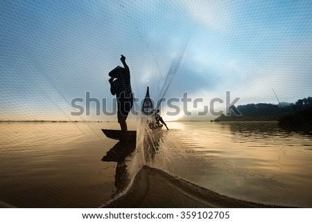 Fisherman casting his net at Mae Klong River, Thailand - stock photo