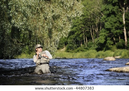 Fisherman catching fish - stock photo