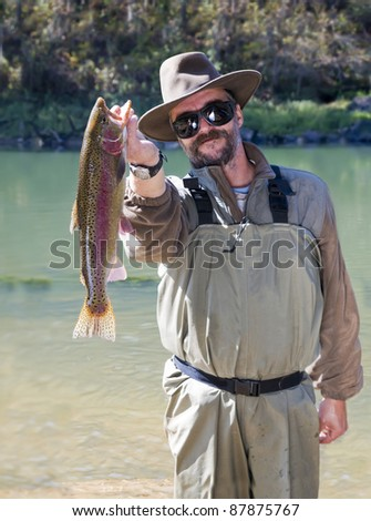 Fisherman caught a big rainbow trout on the Little Red River (Arkansas) - stock photo