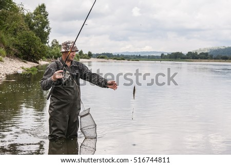 fisherman caught a small fish for bait