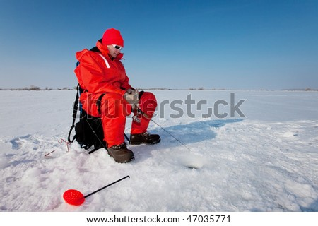 Fisherman enjoying a days fishing on the ice