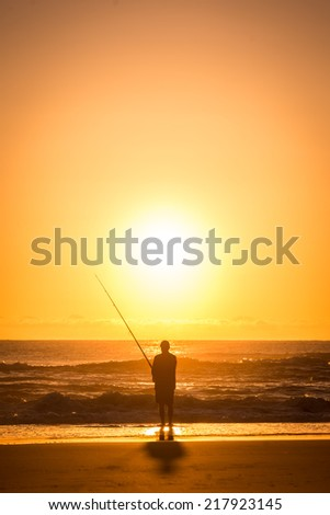 Fisherman fishing at sunrise on the Gold Coast