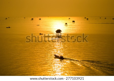 fisherman go to work and the sunrise in the morning at Bang Ta Boon bay - stock photo