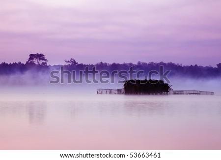 Fisherman huts on Etang Blanc lake at Seignosse in Aquitaine France - stock photo