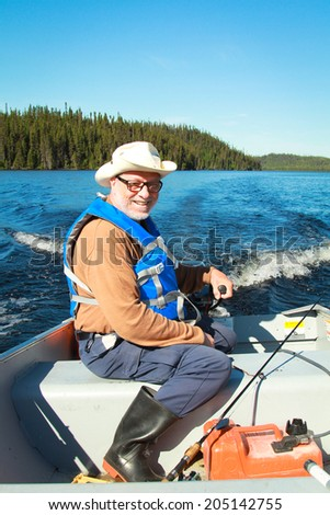 Fisherman in a boat on a lake in Canada