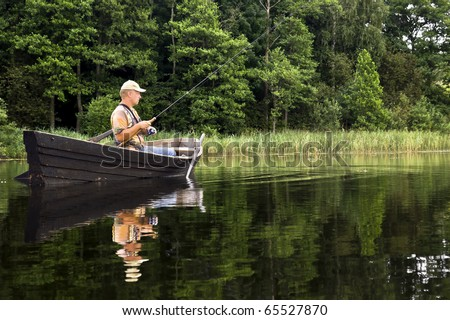 fisherman in action - stock photo