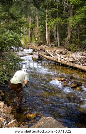 Fisherman in River fly fishing in the Canyons - stock photo