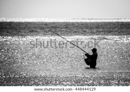 Fisherman in silhouette, Mauritius, Black and white