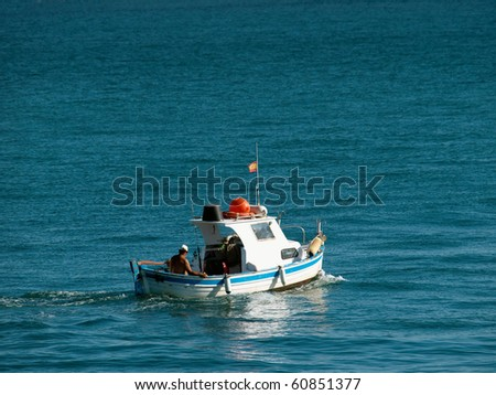 fisherman in small fisher boat on the sea