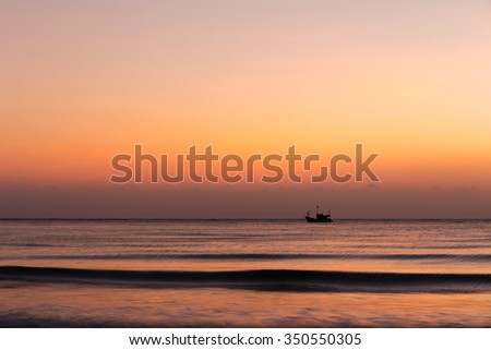 Fisherman in sunrise sky