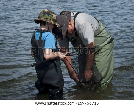 Fisherman in waders fishing at the Eleven Mile Reservoir, Colorado. - stock photo