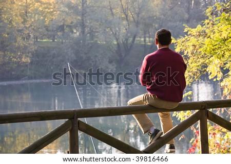 fisherman in waiting - stock photo