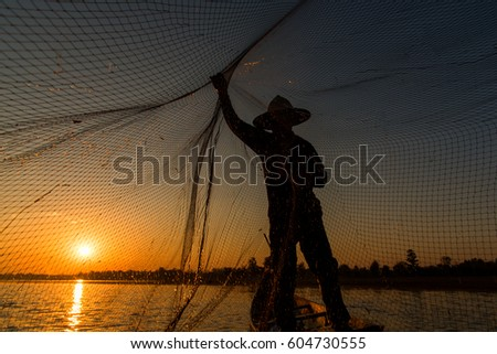 Fisherman is fishing at sunrise.