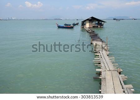 Fisherman jetty at Jelutong, Penang during high tide. - stock photo