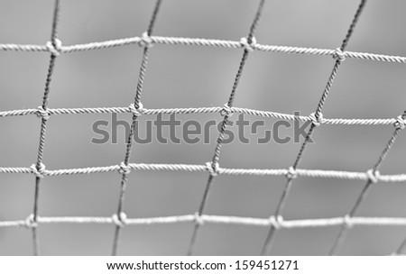 Fisherman net shallow DOF black and white image - stock photo