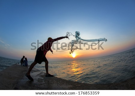 Fisherman of Cha am beach in action when fishing, Thailand - stock photo