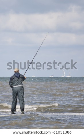 Fisherman on a jetty - stock photo