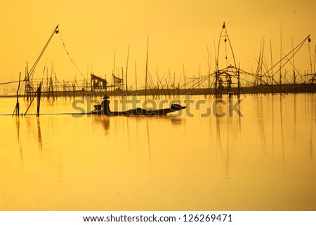 fisherman on boat in morning ,thailand ,Asia