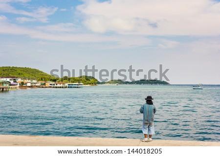 Fisherman on jetty near island and blue sky at Koh Larn,Pattaya,Thailand - stock photo