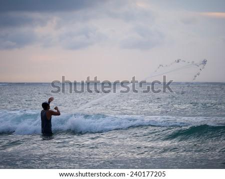 Fisherman on the beach of Kuta in Bali Indonesia - stock photo