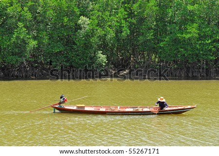 fisherman on the boat at nakornsrithumarat, thailand - stock photo