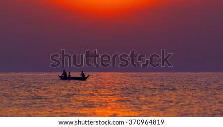 Fisherman on the boat in lake Combodia lake. - stock photo