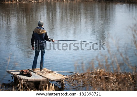 fisherman on the lake