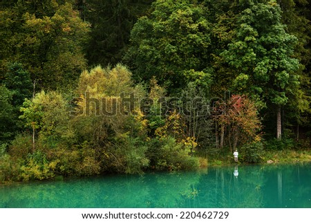 Fisherman on the shore of a lake - stock photo