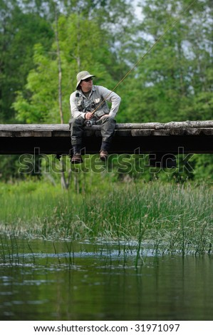 Fisherman resting - stock photo