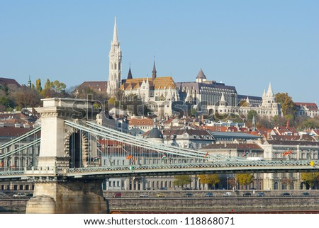 Fisherman's bastion and Matthias church on top of the hill, Chain bridge in foreground, Budapest, Hungary