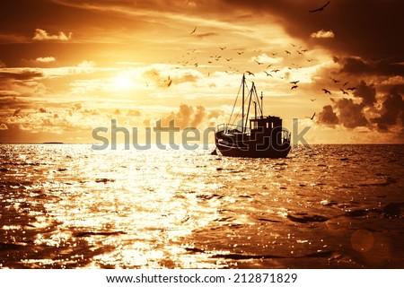 Fisherman's boat in a sea - stock photo