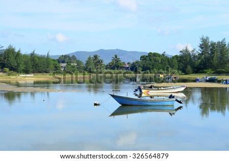 Fisherman's boat in a tranquil bay. - stock photo