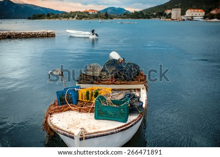 Fisherman's boat with fishing tools on the coast  - stock photo