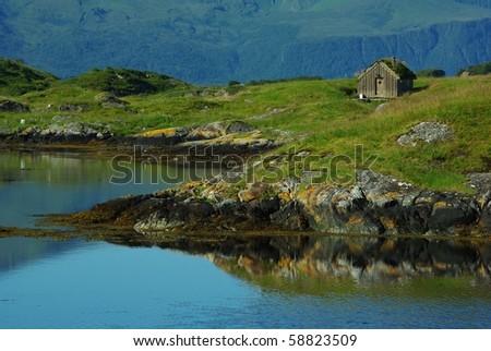 Fisherman's hut on an island in northern Atlantic - stock photo