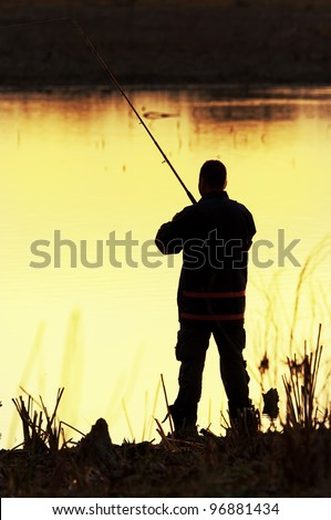 Fisherman silhouette at sunrise