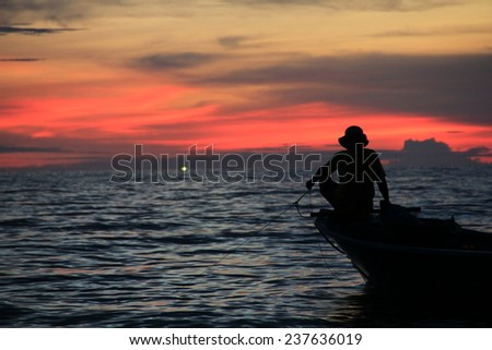 fisherman silhouette with twilight sky