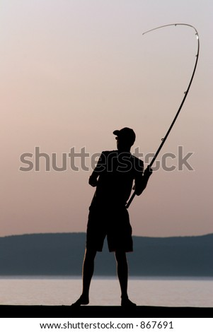 Fisherman silhouetted against the evening light